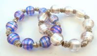 Two Foiled Glass Bead Bracelets.